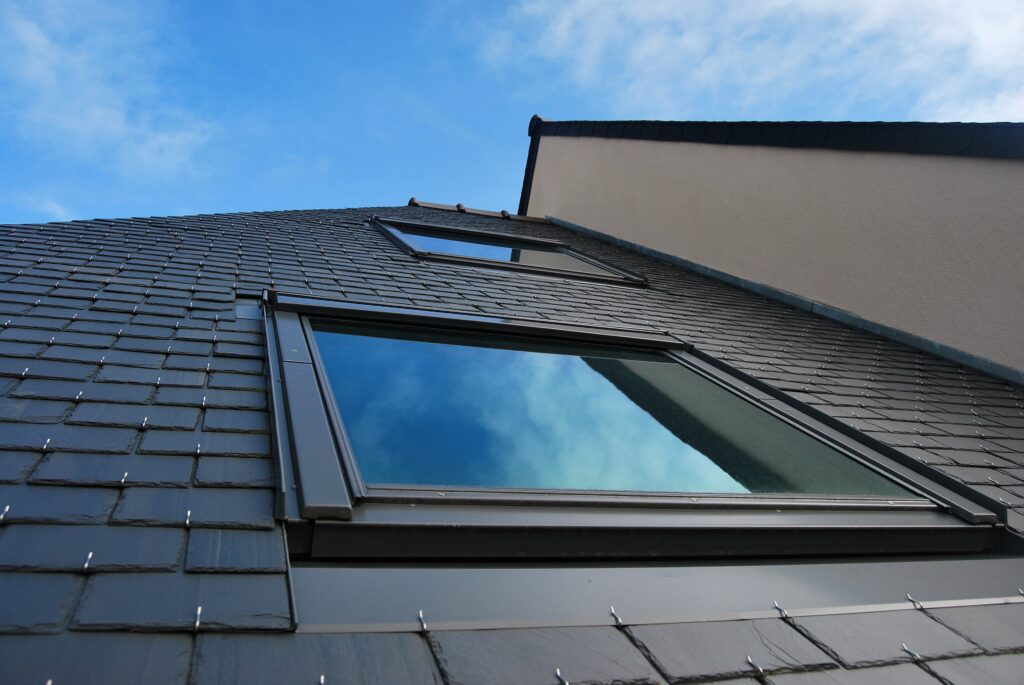 Two rooflights on property tile roof